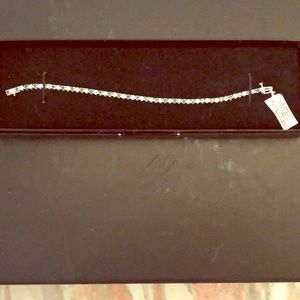 White sapphire and emerald tennis bracelet